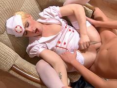 Horny sissified guy in nurse uniform widens his legs in gay...