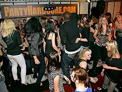 A large group of people, majority of 'em girls, is dancing in a disco....