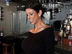 Barmaid with massive round tits!