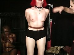 Alt girl is strung up and whipped as some other slave watches