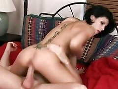 Hot a-hole brunette with tattooed back rides hard cannon in bedroom