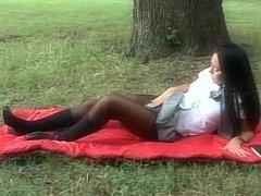 Lengthy haired brunette schoolgirl receives fucked in a park