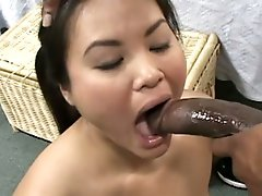 Asian self-conscious sweetheart getting face fucked by a massive dark dick !