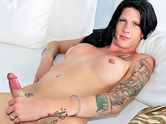 Tattooed ladyboy shows her arse a& penis and that babe enjoys it!...
