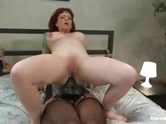 Appealing whore that likes anal penetration fuck herself with a large dark strap-on
