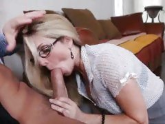 X-rated Angela Attison engulfing cock in the office