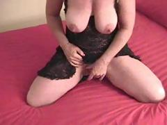 Busty mature with a very big clit is masturbating solo masturbation