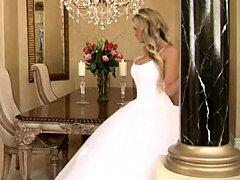 Bride in charming wedding costume widening legs