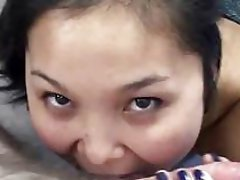 Asian Lucy swallowing a knob in this First person view scene