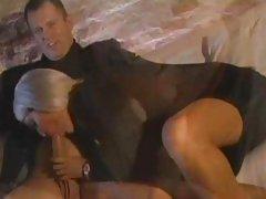 Nice-looking Bridgette B wraps her lips round a giant weenie