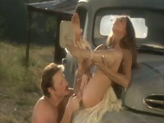 Fleshly jet-black hair girl on top receives her wet crack fucked on the classics truck next to the barn