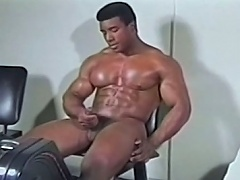 Enticing darksome homo getting his big dick hard during the time that exercising...