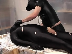 Masked and in darksome latex, these 2 pretty dads are really...
