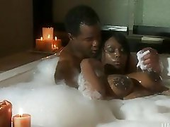 Beautiful swarthy with giant boobs does blowjob in bathroom