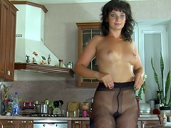 Charming chick settles for black fashion pantyhose to go with her navy blue...