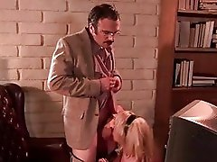 Sluty blond with big breasts gives blowjob to nerdy hunk in office