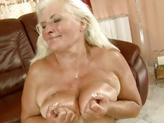Old school bitch Judi taking huge cum load all over tits
