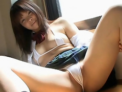 Cosplay beauty Minami Fujimura shows some cameltoe and gets her muff gratified with a vibrator.