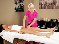 Blonde masseuse gives Megan a sexy massage and rubs her pussy