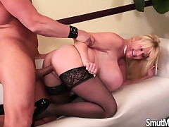 Giant breasted blonde cougar in stockings has a passion for youthful meat