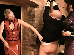 Mistress Carmen has help as this babe tortures some dudes in the air an audience