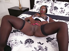 Spectacular baleful hustler with big breasts added to plump tokus flashes her cunt on high dramatize expunge bed