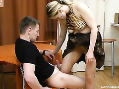 Frisky playgirl teasing fellow with her pantyhosed legs till grand admirable legjob